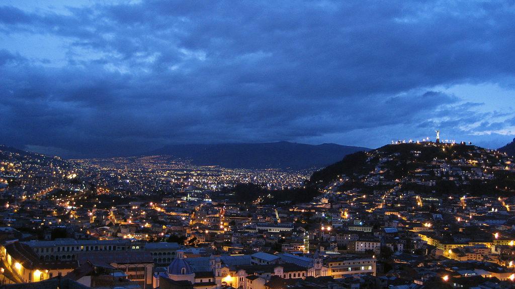Panoramic nighttime view of Quito