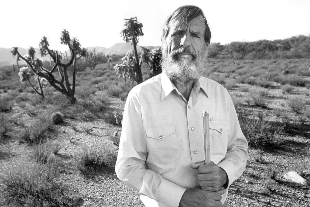 Edward Abbey, the author of the book pictured in the desert