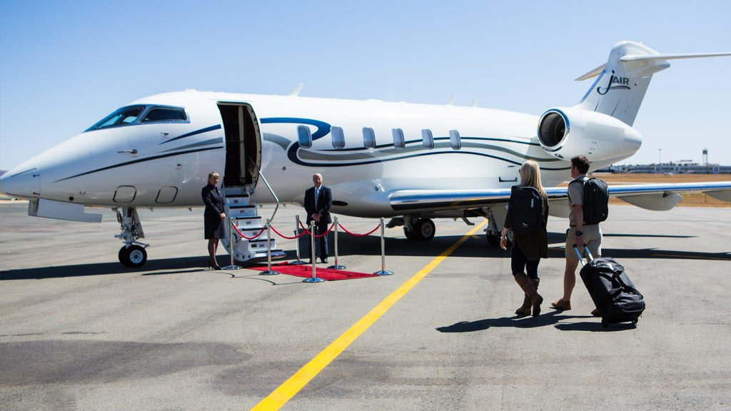 Couple boarding on a private jet