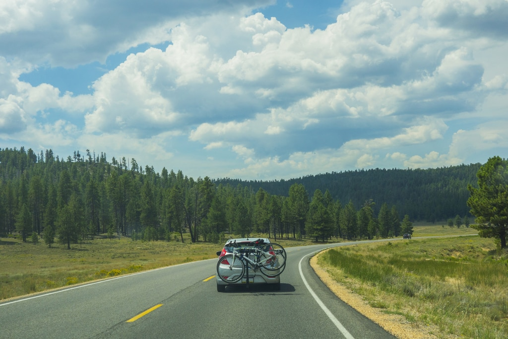 Car carrying bikes on the road, Yosemite National Park, USA