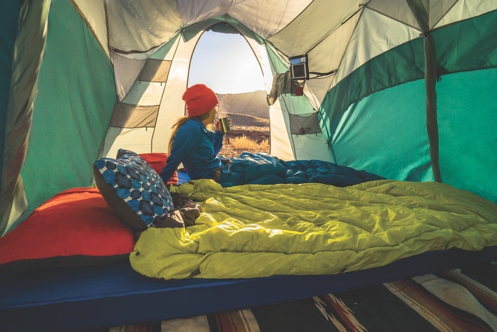 inside a backpacker's tent with a yellow quilt on the floor