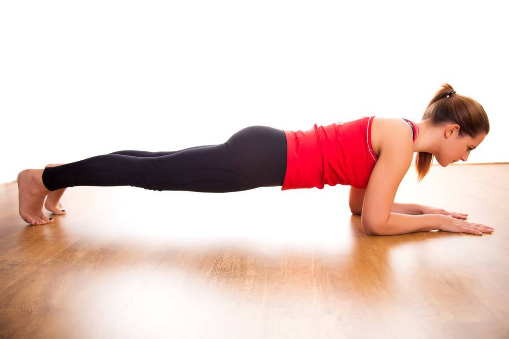 young woman doing a plank exercise