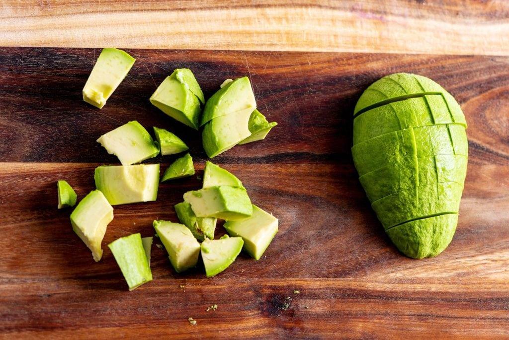 cut avocado on a kitchen board