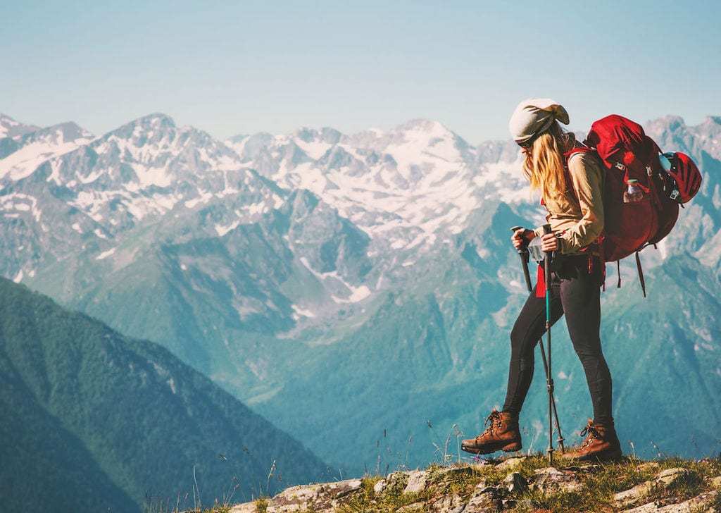 Young backpacker hiking in the mountains