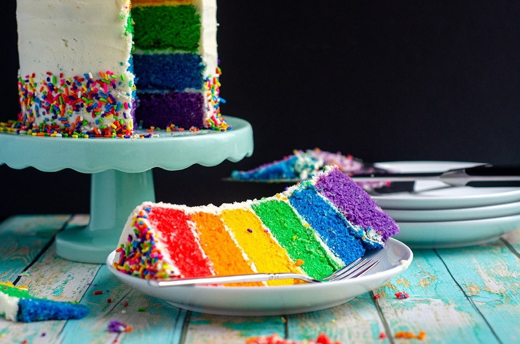 Rainbow cake with red, orange, yellow, green, blue, and purple layers